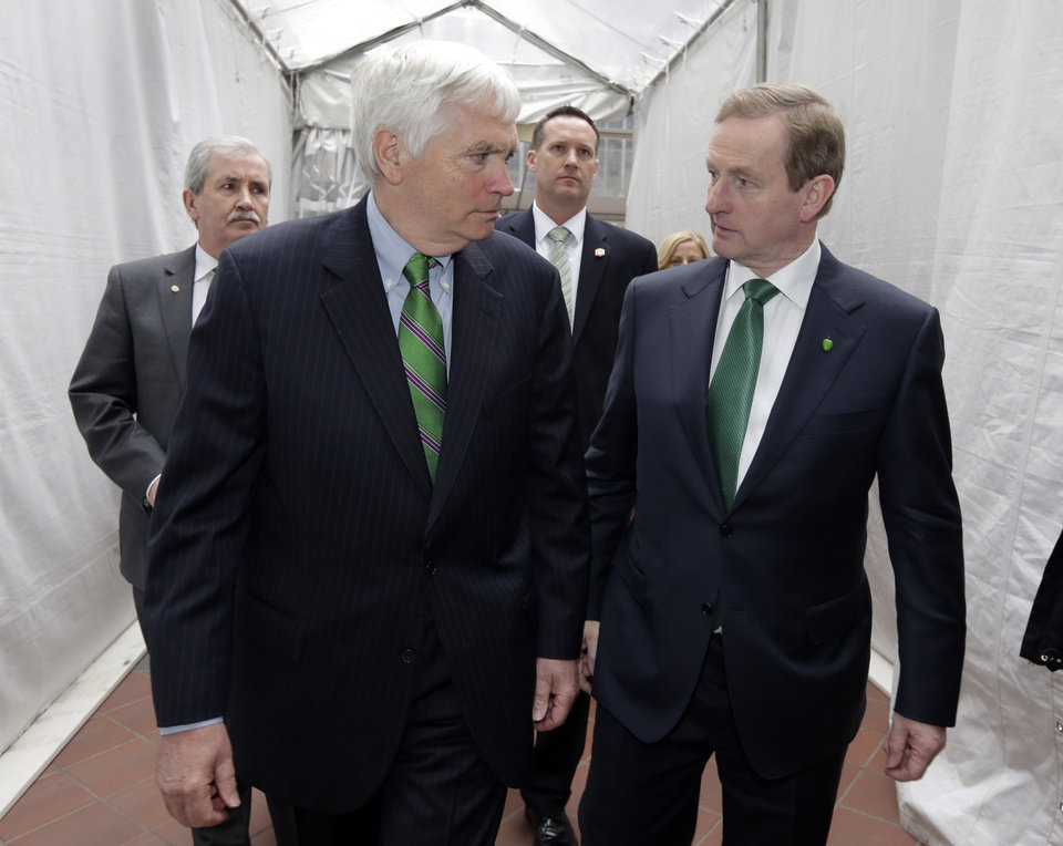 Photo - Irish Prime Minister Enda Kenny, right, walks with Brian O'Dwyer, Chairman of the Ireland Chamber of Commerce, as he arrives for the 17th annual St. Patrick's Day Breakfast, in New York,  Saturday, March 16, 2013. The Irish, their descendants and the Irish for the day prepared to don green and pay tribute to Hibernian heritage as a weekend of St. Patrick's Day celebrations was set from New York's Fifth Avenue to the Louisiana bayou to Dublin's Parnell Square.   (AP Photo/Richard Drew)