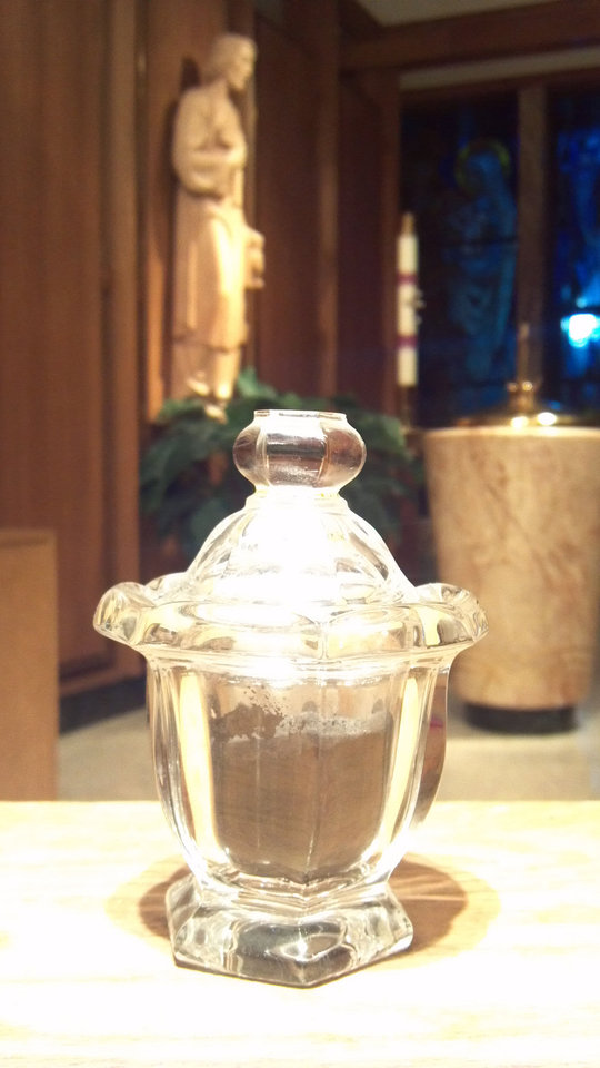 Photo - A glass container is filled with ashes that will be used for the impostion of ashes at the Ash Wednesday services at Christ the King Catholic Church in Nichols Hills. Photo provided