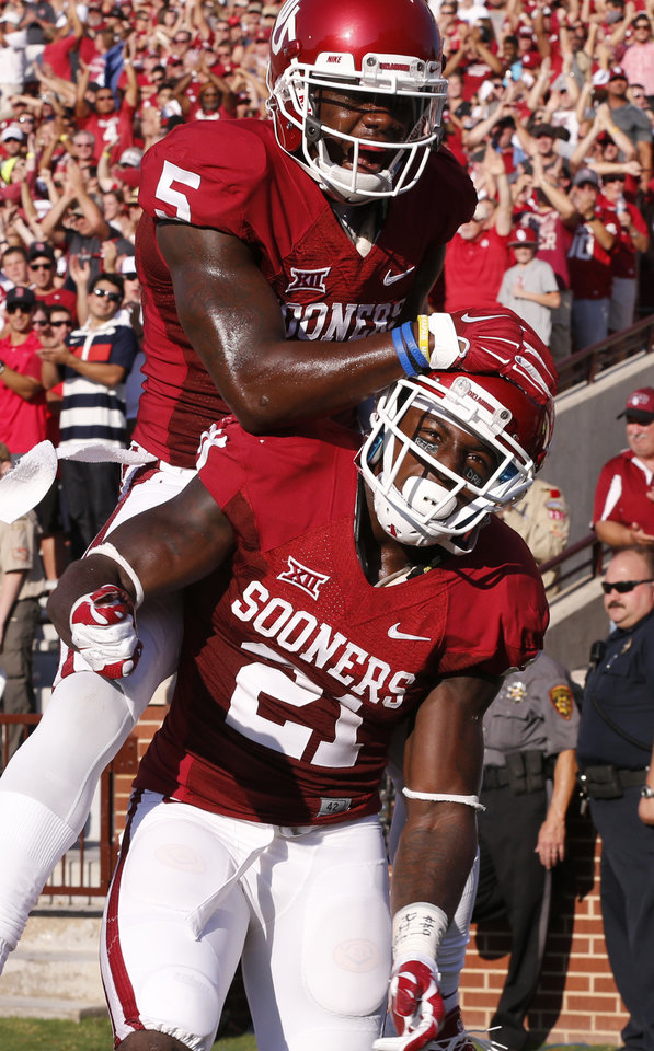 Photo - Oklahoma Sooners's Keith Ford is congratulated on his score by Durron Neal (5) during a college football game between the University of Oklahoma Sooners (OU) and the Louisiana Tech Bulldogs at Gaylord Family-Oklahoma Memorial Stadium in Norman, Okla., on Saturday, Aug. 30, 2014. Photo by Steve Sisney, The Oklahoman