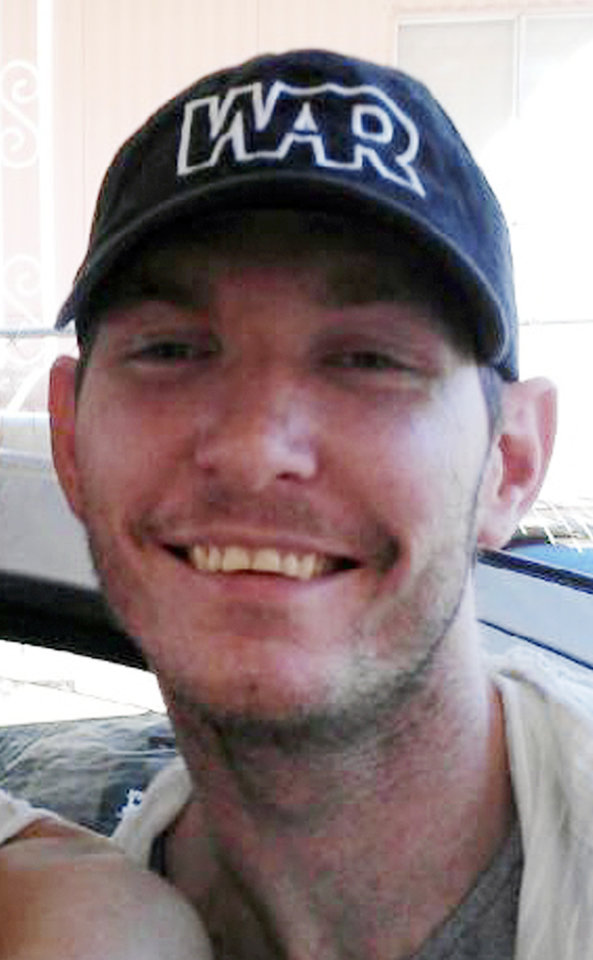 Photo - This undated file image provided courtesy of Jeremy Tanner, shows Las Vegas shooting victim Joseph Wilcox. A community that has mourned two Las Vegas police officers killed by a couple on a shooting rampage two weeks ago gathered again to eulogize Wilcox, a 31-year-old man hailed as a hero for dying while trying to stop the rampage.  (AP Photo/Jeremy Tanner)