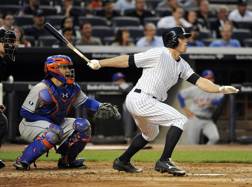 Photo - New York Yankees' Brett Gardner hits a grand slam off of New York Mets starting pitcher Bartolo Colon as Travis d'Arnaud catches for the Mets in the second inning of an interleague baseball game at Yankee Stadium on Monday, May 12, 2014, in New York. (AP Photo/Kathy Kmonicek)