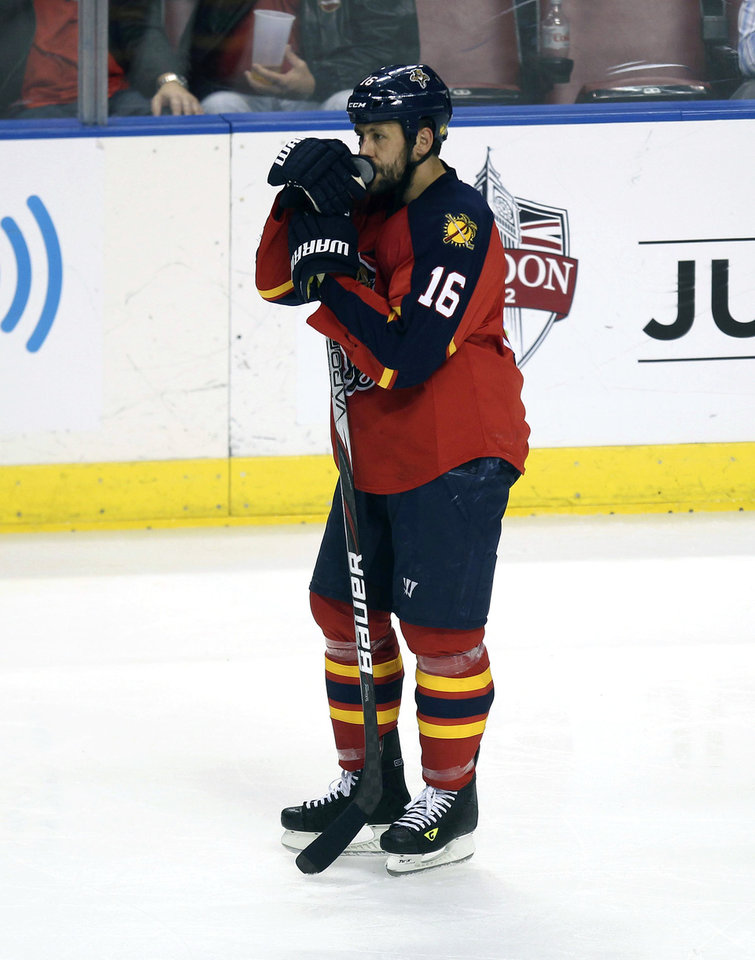 Photo -   Florida Panthers' Marco Sturm stands alone after the New Jersey Devils won during the second overtime period of Game 7 in a first-round NHL Stanley Cup playoff hockey series in Sunrise, Fla., Thursday, April 26, 2012. The Devils won 3-2. (AP Photo/J Pat Carter)