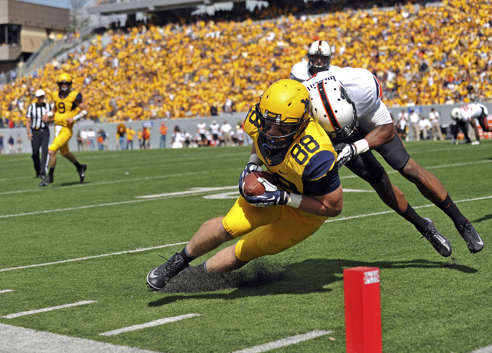 West Virginia running back Cody Clay (88) barrels in for a touchdown in the second quarter of an NCAA college football game against Oklahoma State in Morgantown, W.Va., on Saturday, Sept. 28, 2013. (AP Photo/Tyler Evert) ORG XMIT: WVTE302