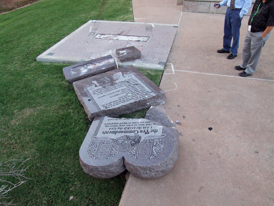 Photo -  This photo, provided by the state Office and Management and Enterprise Services, shows the broken pieces of the Ten Commandments monument Friday after it a man smashed his car into the granite monument at the state Capitol. Photo provided