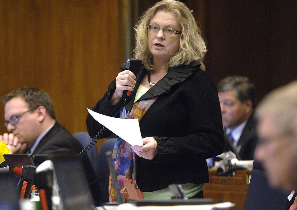 Photo - Rep. Gail Mooney, D-Cummings, speaks against division A of SB2303 during floor debate, Friday, March 22, 2013 at the state Capitol in Bismarck, N.D. Long dismissed as cold and inconsequential, North Dakota is now trying to enact the toughest abortion restrictions in the nation. The newly oil-rich red state may soon find itself in a costly battle over legislation foes describe as blatantly unconstitutional.  (AP Photo/The Bismarck Tribune, Mike McCleary)