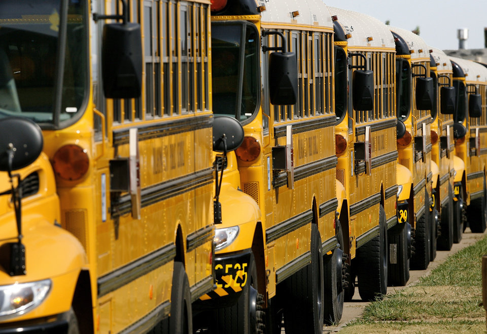 Oklahoma City school buses lined up at the district's transportation center in northeast Oklahoma City, Thursday,  Aug. 7, 2008.   BY JIM BECKEL, THE OKLAHOMAN