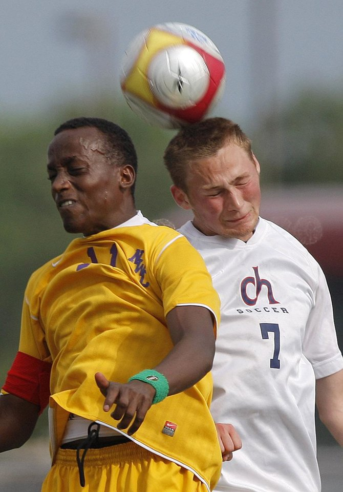 Northwest Classen's Niyo Moise and Cascia Hall's George Howard fight for a ball during the boys 5A soccer state championship game between Northwest Classen and Cascia Hall at Edmond North High School in Edmond, Okla., Saturday, May 12, 2012. Photo by Sarah Phipps, The Oklahoman