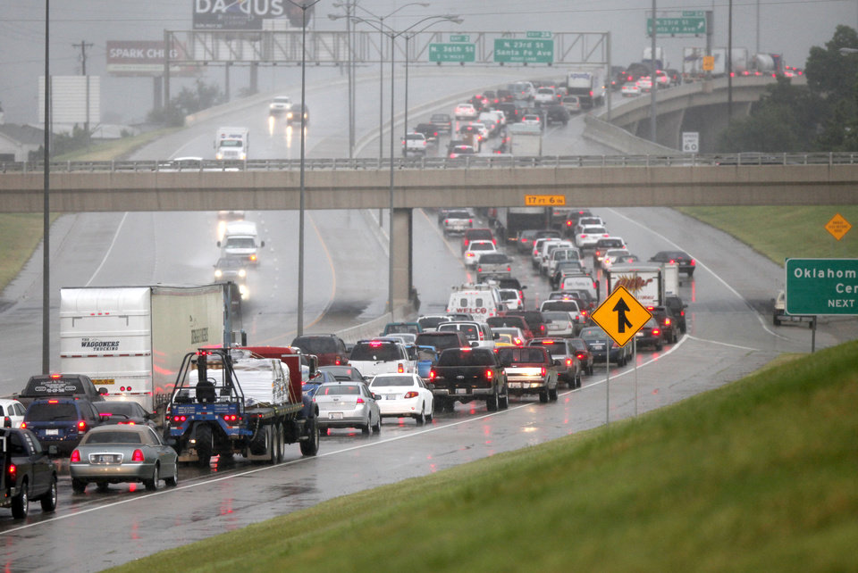 Photo - Cars are at a standstill on northbound Broadway Extension in Oklahoma City, OK, after heavy rains caused widespread flooding in the metro, Monday, June 14, 2010. By Paul Hellstern, The Oklahoman