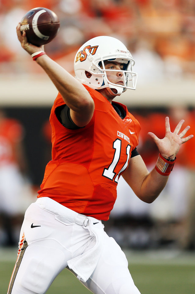 Photo - OSU's Wes Lunt (11) passes during a college football game between Oklahoma State University (OSU) and Savannah State University at Boone Pickens Stadium in Stillwater, Okla., Saturday, Sept. 1, 2012. Photo by Nate Billings, The Oklahoman