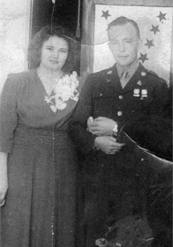 Photo - In this undated family photo provided by Kevin Smith is a wedding picture of Pfc. John Farrell Eddington and his wife, Helen. Seven decades after the Missouri soldier died in World War II, Peggy Smith, the daughter he never met is about to get his Purple Heart medal, along with the emotional letter her father wrote just weeks after her birth, at a ceremony Saturday, Sept. 21, 2013, in Dayton, Nev. (AP Photo/Courtesy Kevin Smith)