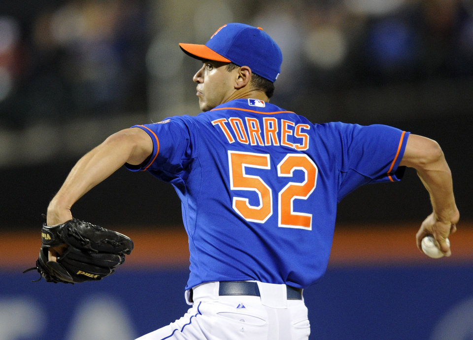 Photo - New York Mets pitcher Carlos Torres delivers the ball to the Milwaukee Brewers during the first inning of a baseball game Friday, Sept. 27, 2013, in New York. (AP Photo/Bill Kostroun)