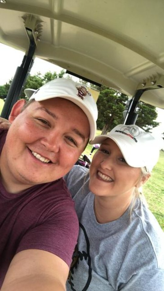Photo -  Cashion assistant coach Cale Cochran, left, and his wife Jacie are pictured on a golf outing. [Photo provided]