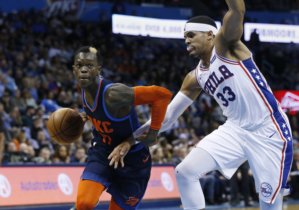 Photo - Oklahoma City Thunder guard Dennis Schroeder (17) drives past Philadelphia 76ers forward Tobias Harris (33) during the second half of an NBA basketball game Thursday, Feb. 28, 2019, in Oklahoma City. (AP Photo/Sue Ogrocki)