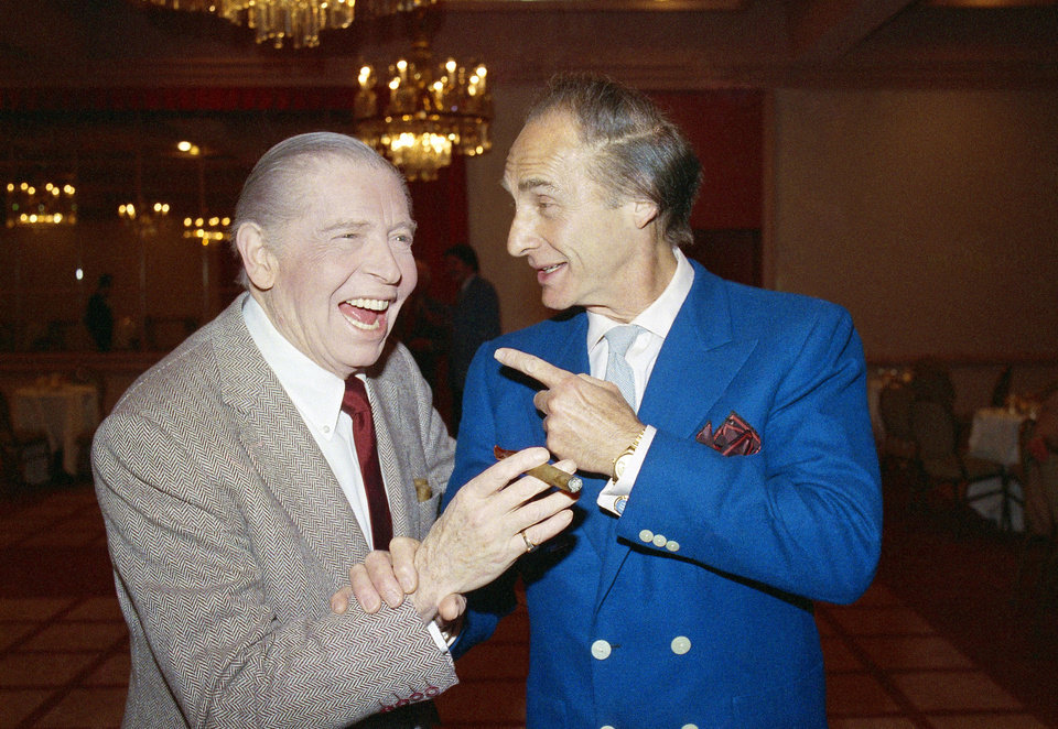 Photo - FILE - This April 15, 1986 file photo shows comedians Milton Berle, left, and Sid Caesar prior to Caesar's roast in Beverly Hills, Calif. Caesar, whose sketches lit up 1950s television with zany humor, died Wednesday, Feb. 12, 2014. He was 91.  (AP Photo/Michael Tweed, File)