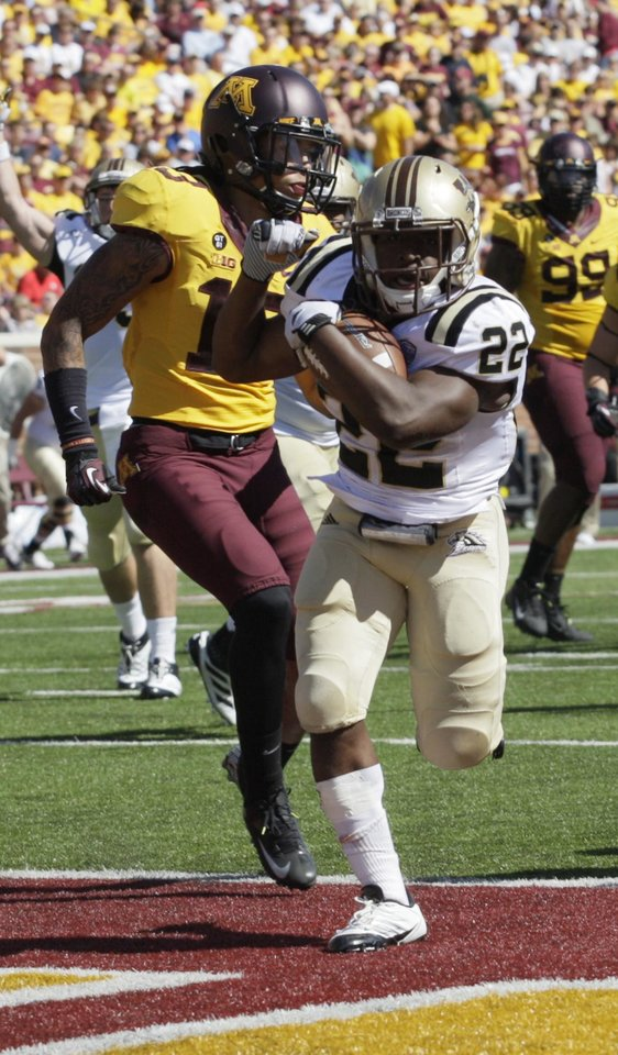 Photo -   Western Michigan running back Dareyon Chance (22) scores on a 6-yard run against Minnesota during the first half of an NCAA football game, Saturday, Sept. 15, 2012, in Minneapolis. (AP Photo/Paul Battaglia)