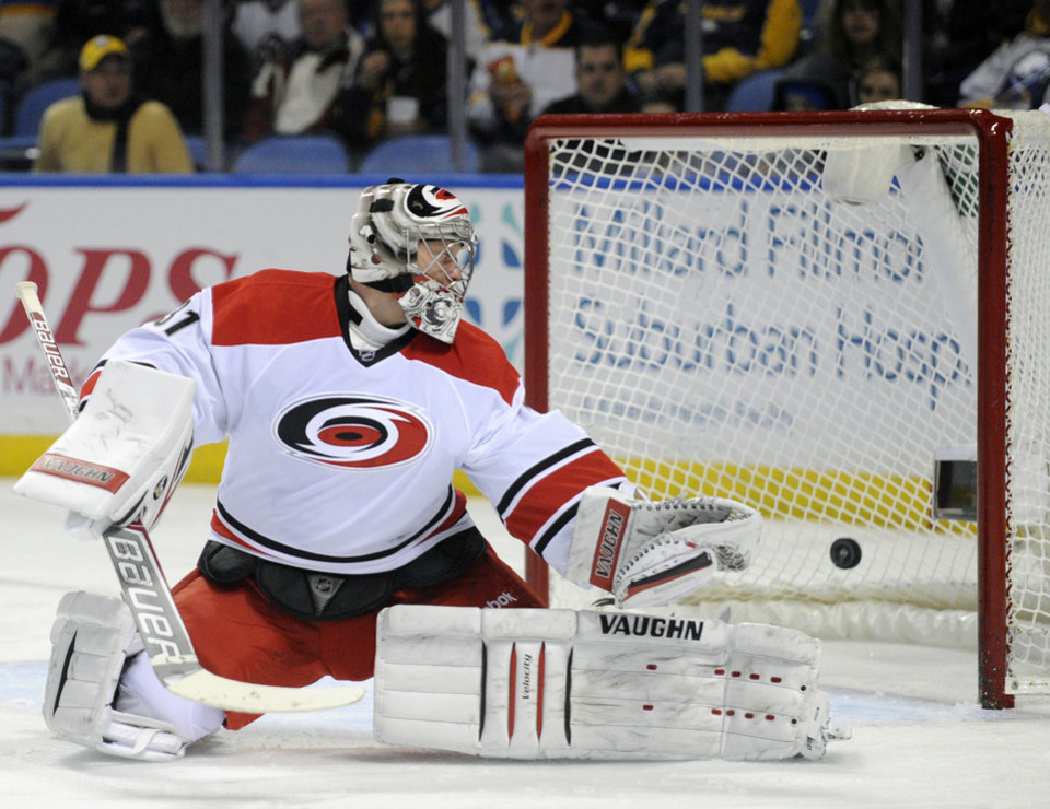 Photo - Carolina Hurricanes goaltender Anton Khudobin, of Russia, looks back after he is beaten for a goal by Buffalo Sabres'  Cody Hodgson during the first period of an NHL hockey game in Buffalo, N.Y., Thursday, Jan. 23, 2014. (AP Photo/Gary Wiepert)