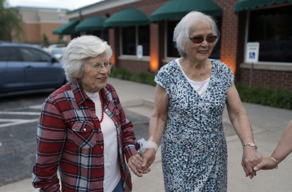 Sadie Fanali and Lorraine Thomas hold hands as the walk to dinner after meeting for the first time at Will Roger World Airport, Friday, June 14, 2013, in Oklahoma City.  The pair have been pen pals since 1932. Photo by Sarah Phipps, The Oklahoman