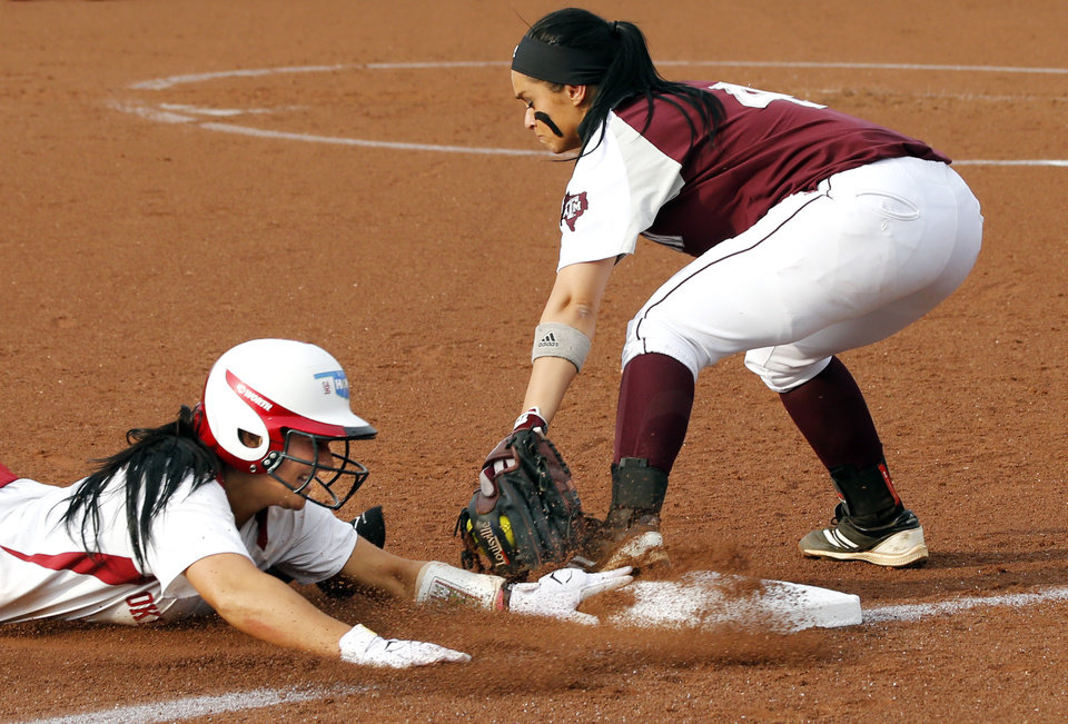 Sooner Lauren Chamberlain is called out at third on a tag by Amber Garza in the NCAA Super Regional softball game as the University of Oklahoma (OU) Sooners defeats Texas A&M 10-2 at Marita Hines Field on Friday, May 24, 2013 in Norman, Okla. Photo by Steve Sisney, The Oklahoman