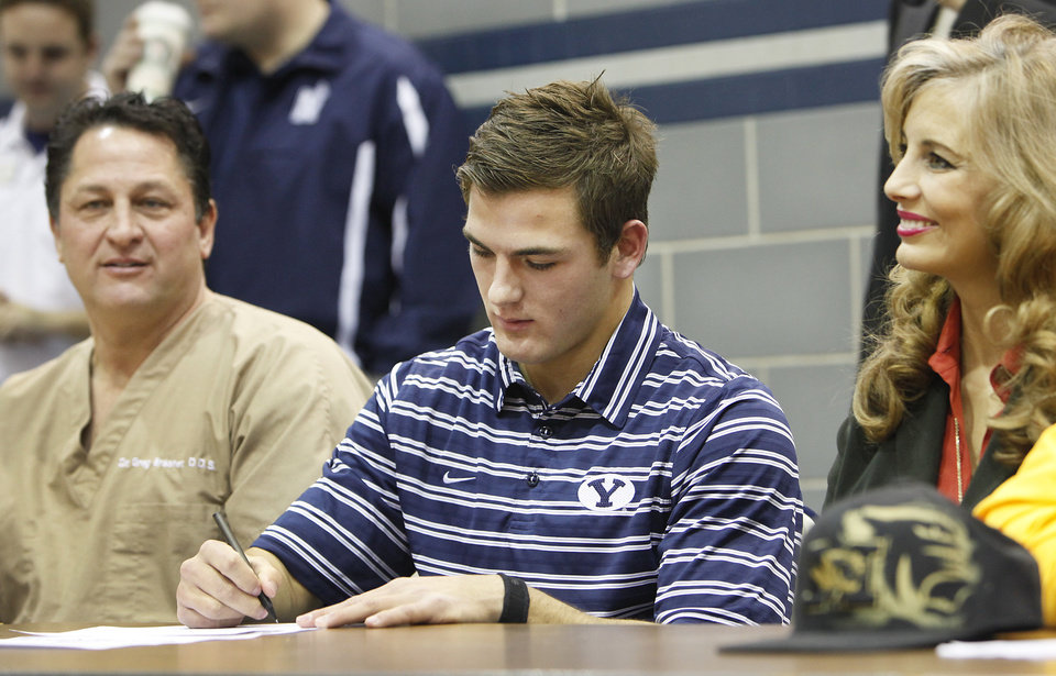 Edmond North's Austin Brasher signs a letter of intent to play college football at Brigham Young on Wednesday, Feb. 3, 2010. Photo by David McDaniel, The Oklahoman