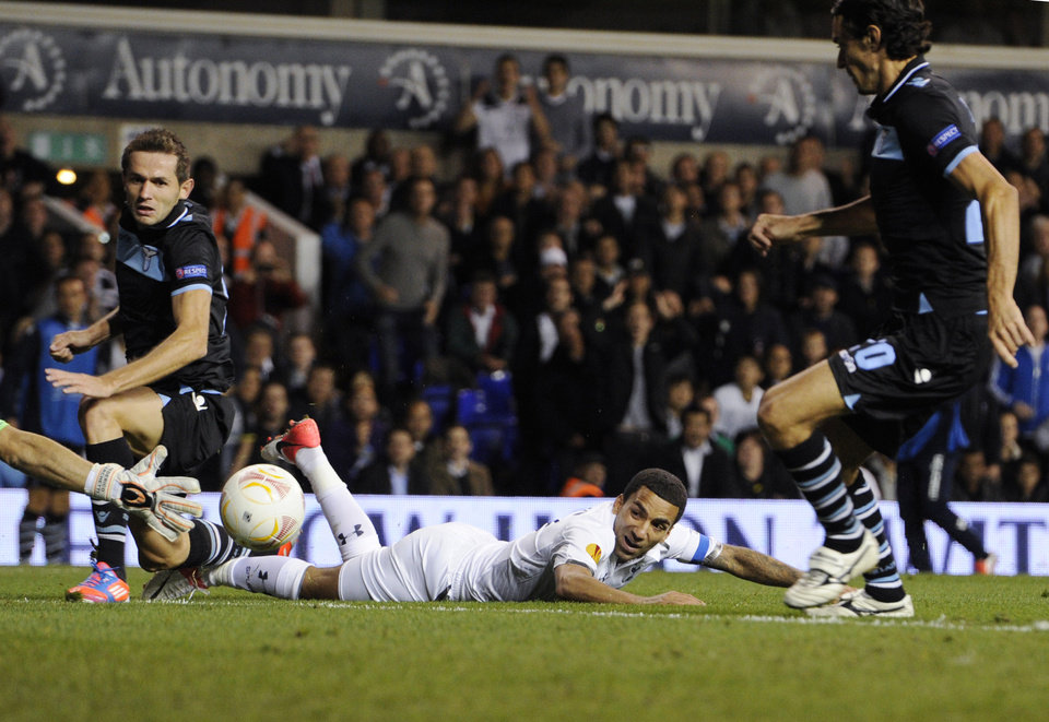 Photo -   Tottenham Hotspur's captain Aaron Lennon, on the ground, tries unsuccessfully to score against Lazio during a Europa League Group J soccer match at White Hart Lane ground in London, Thursday, Sept. 20, 2012. (AP Photo/Tom Hevezi)