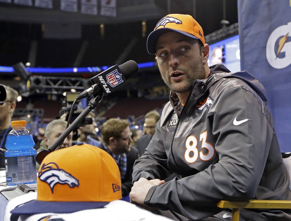 Photo - Denver Broncos' Wes Welker answers a question during media day for the NFL Super Bowl XLVIII football game Tuesday, Jan. 28, 2014, in Newark, N.J. (AP Photo/Mark Humphrey)