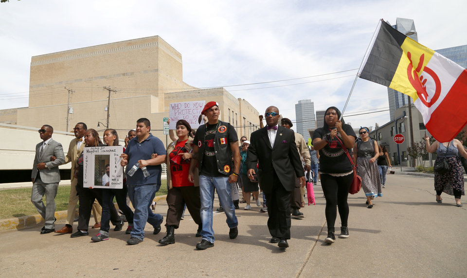 Photo - Protestors march during the Justice for Magdiel Sanchez rally in Oklahoma City, Sunday, Sept. 24, 2017. Photo by Sarah Phipps, The Oklahoman