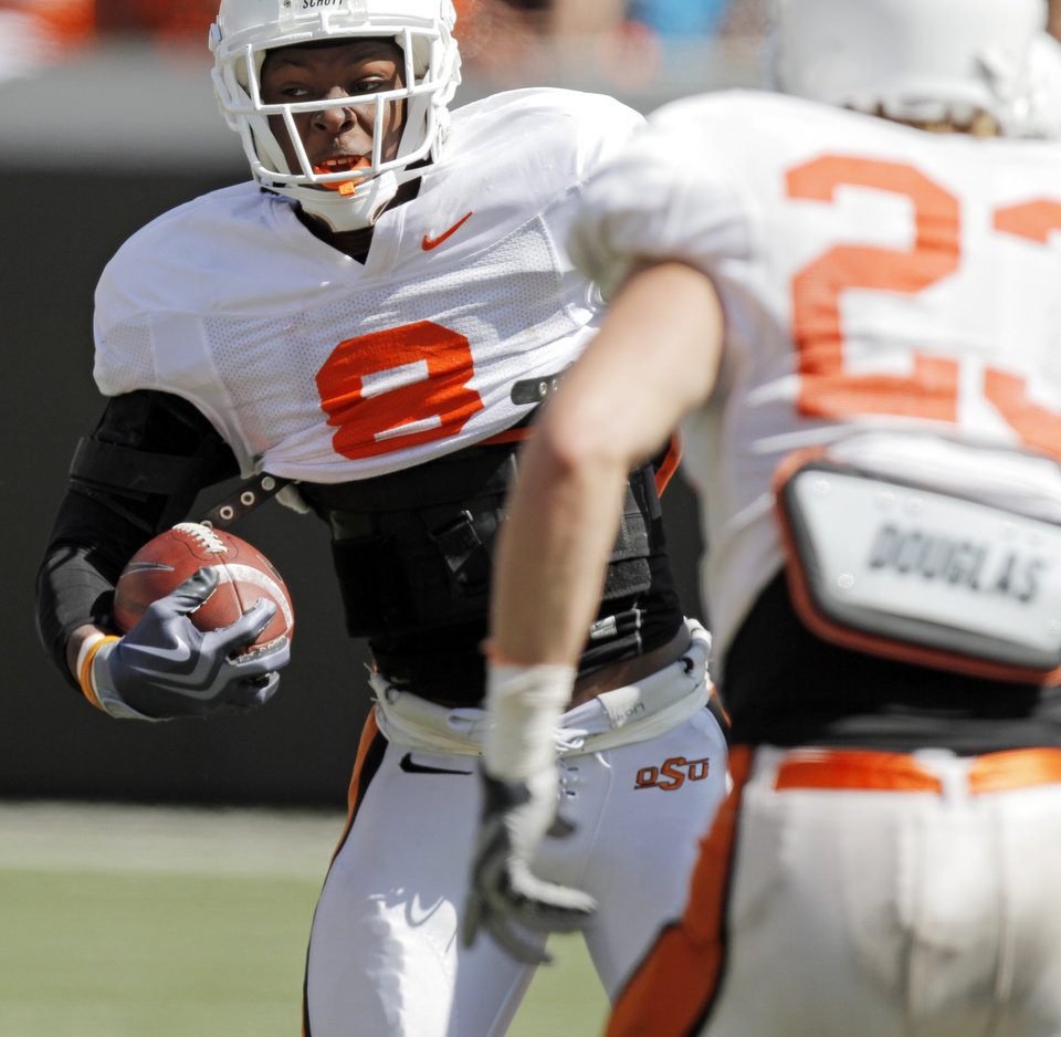 OSU\'s Daytawion Lowe (8) returns an interception during the Orange/White spring football game for the Oklahoma State University Cowboys at Boone Pickens Stadium in Stillwater, Okla., Saturday, April 16, 2011. Photo by Nate Billings, The Oklahoman