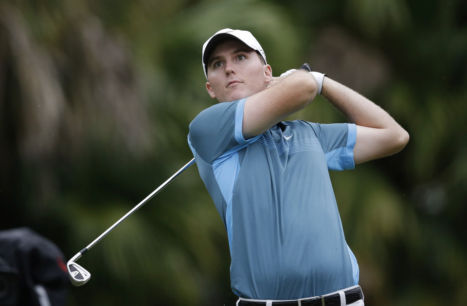 Photo - Russell Hunley watches from the 13th tee during the first round of the Cadillac Championship golf tournament Thursday, March 6, 2014, in Doral, Fla. (AP Photo/Wilfredo Lee)