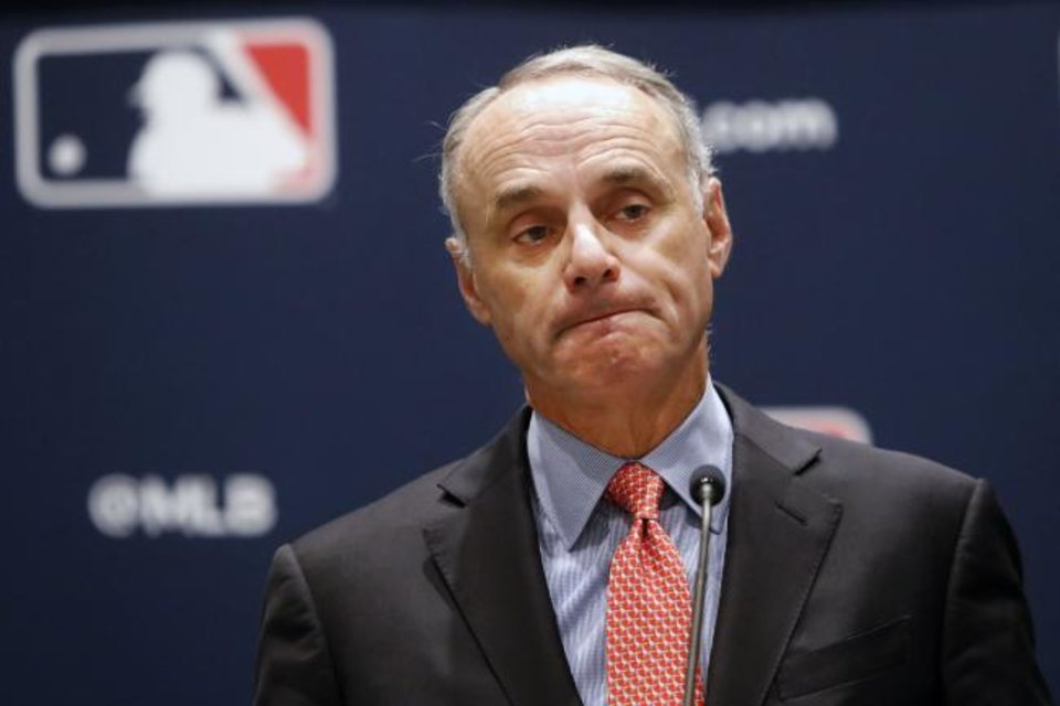 Photo -  Baseball commissioner Rob Manfred pauses while speaking to the media at the owners meeting on Nov. 21 in Arlington, Texas. [AP Photo/LM Otero]