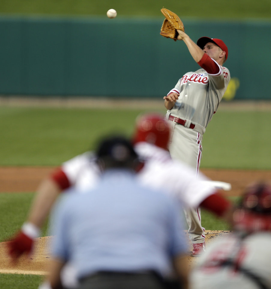 Photo - Philadelphia Phillies starting pitcher David Buchanan cannot catch a line drive hit back to him by St. Louis Cardinals' Matt Holliday during the first inning of a baseball game on Thursday, June 19, 2014, in St. Louis. Holliday was thrown out at first by Phillies shortstop Jimmy Rollins on the play. (AP Photo/Jeff Roberson)