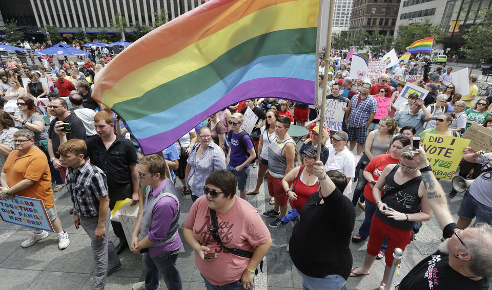 Photo - Hundreds of gay marriage supporters rally on Fountain Square, Wednesday, Aug. 6, 2014, in Cincinnati. Three judges of the 6th U.S. Circuit Court of Appeals in Cincinnati are set to hear arguments Wednesday in six gay marriage fights from four states, Kentucky, Michigan, Ohio and Tennessee. (AP Photo/Al Behrman)