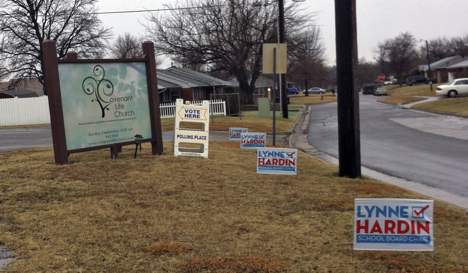 campaign signs for Oklahoma City School Board chairwoman candidate Lynne Hardin are posted outside a polling place Tuesday morning in northwest Oklahoma City. Poll workers said they were waiting for supervisors to remove the signs. THE OKLAHOMAN