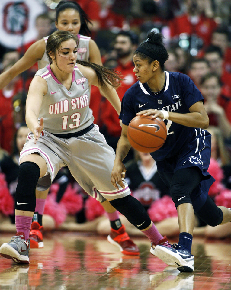 Photo - Ohio State's Cait Craft (13) guards Penn State's Dara Taylor during the second half of an NCAA women's college basketball game, Sunday, Feb. 9, 2014, in Columbus, Ohio. Penn State won 74-54. (AP Photo/Mike Munden)