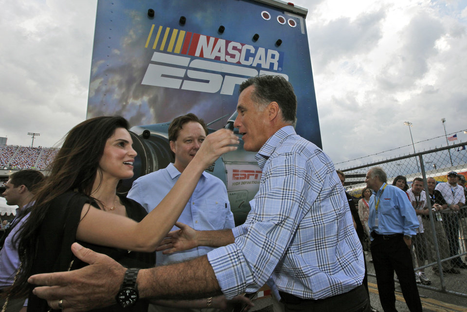 Photo -   Republican presidential candidate Mitt Romney, right,greets NASCAR chairman Brian France, center rear, and his wife Amy France during a visit to the NASCAR Sprint Cup Series auto race at the Richmond International Raceway in Richmond, Va., Saturday, Sept. 8, 2012. (AP Photo/Steve Helber)