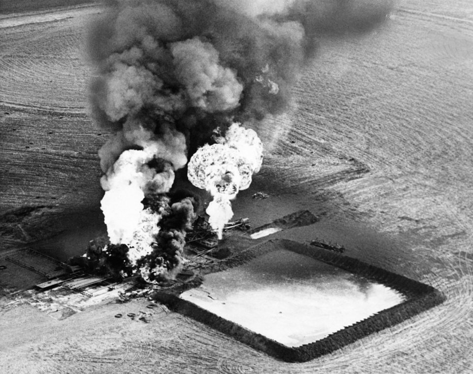 A fire burns at an oil storage tank in Canton in 1964.