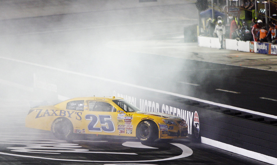 Photo - John Wes Townley near the inside wall during the NASCAR Nationwide series auto race at Bristol Motor Speedway on Friday, Aug. 22, 2014, in Bristol, Tenn. (AP Photo/Wade Payne)