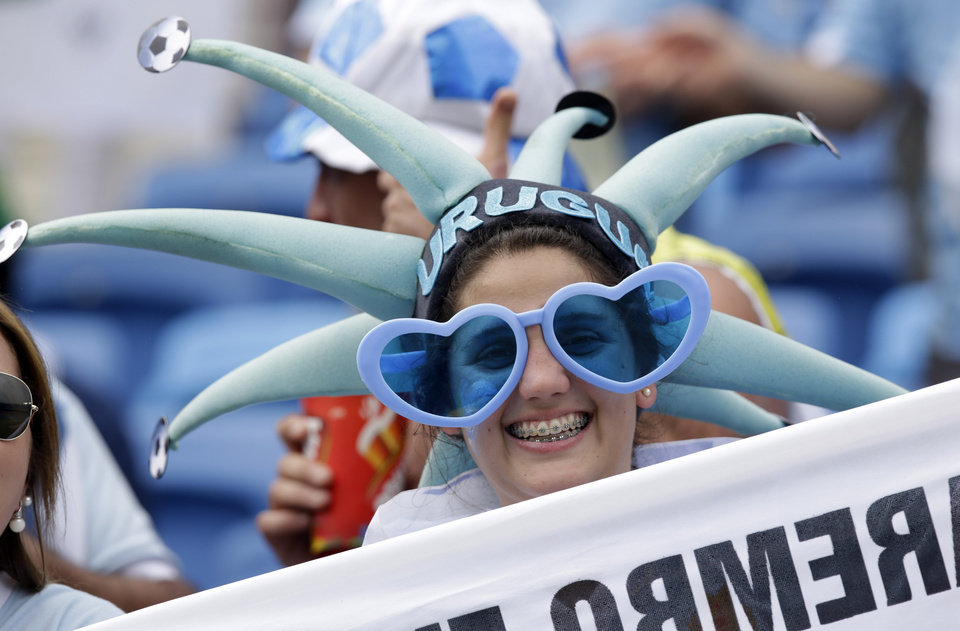 Photo - An Uruguay fan smiles during the group D World Cup soccer match between Italy and Uruguay at the Arena das Dunas in Natal, Brazil, Tuesday, June 24, 2014. (AP Photo/Andrew Medichini)