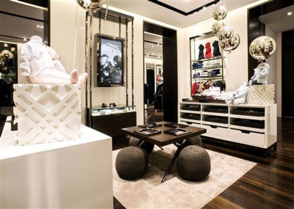 This undated publicity photo provided by BURBERRY shows an interior of the children's section of the new BURBERRY Flagship store opened in November 2012 on Michigan Avenue in Chicago. BURBERRY has been known for generations for its signature check pattern and trenchcoat.  The company has monthly updates at Burberry.com, where CEO, Angela Ahrendts said, more people visit every week than walk into all the brand's stores around the world combined. (AP Photo/BURBERRY)
