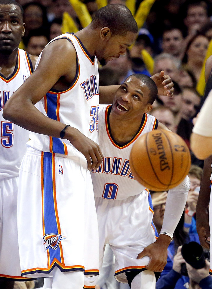 Oklahoma City\'s Kevin Durant (35) and Russell Westbrook (0) celebrate a play during the NBA basketball game between the Oklahoma City Thunder and the Portland Trail Blazers at the Chesapeake Energy Arena in Oklahoma City, Sunday, March, 24, 2013. Photo by Sarah Phipps, The Oklahoman