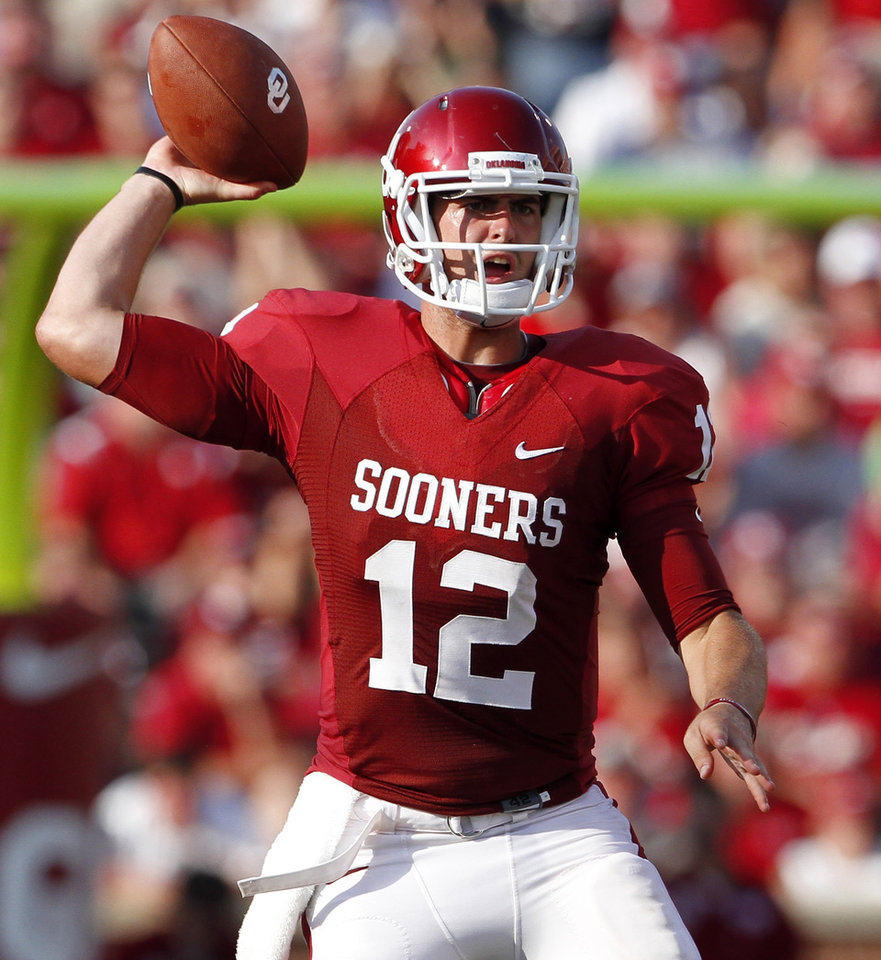Photo - OU's Landry Jones throws a pass during the second half of the college football game between the University of Oklahoma Sooners (OU) and Air Force (AF) at the Gaylord Family-Oklahoma Memorial Stadium on Saturday, Sept. 18, 2010, in Norman, Okla.   Photo by Bryan Terry, The Oklahoman