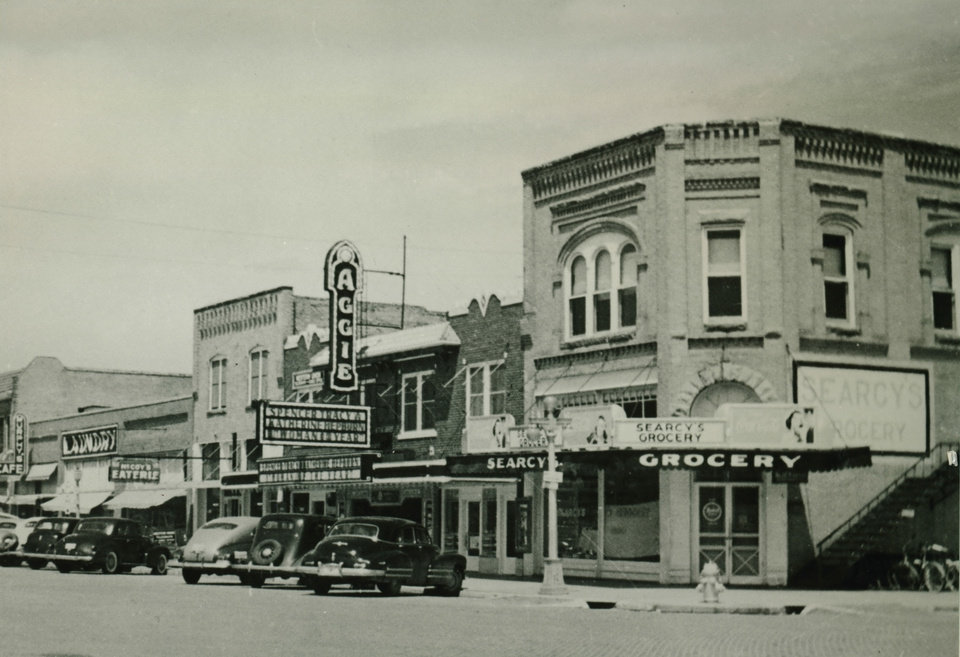 Photo -  Downtown Stillwater circa 1940s. Seen here, Searcy's Grocery and The Aggie Theater have been renovated by Russ Teubner into office and entertainment spaces. Photo provided