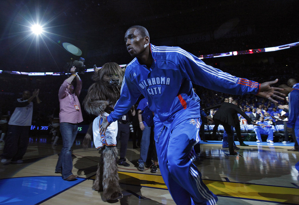 Photo - Oklahoma City's Serge Ibaka (9) goes through team introductions during the first round NBA playoff game between the Oklahoma City Thunder and the Denver Nuggets on Sunday, April 17, 2011, in Oklahoma City, Okla. Photo by Chris Landsberger, The Oklahoman