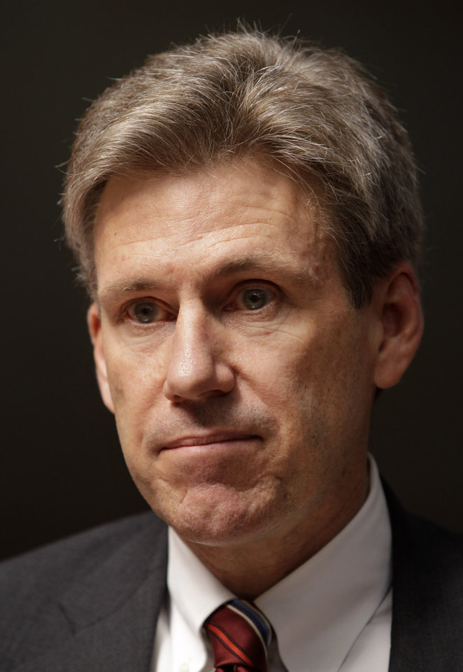Photo - FILE - This April 11, 2011 file photo shows U.S. envoy Chris Stevens in the lobby of the Tibesty Hotel in Benghazi, Libya. To congressional Republicans,
