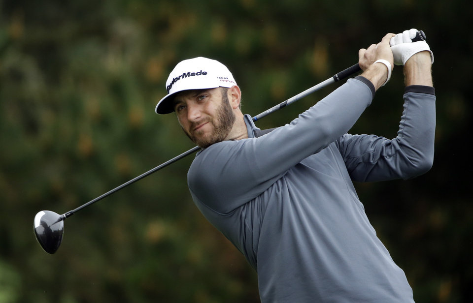 Photo - Dustin Johnson hits off the second tee on Sunday, Feb. 9, 2014, during the final round of the AT&T Pebble Beach Pro-Am golf tournament in Pebble Beach, Calif. (AP Photo/Ben Margot)