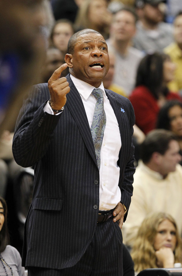 Photo - Los Angeles Clippers head coach Doc Rivers gestures to his players during the first quarter of an NBA basketball game against the Minnesota Timberwolves in Minneapolis, Monday, March 31, 2014. The Clippers won 114-104. (AP Photo/Ann Heisenfelt)