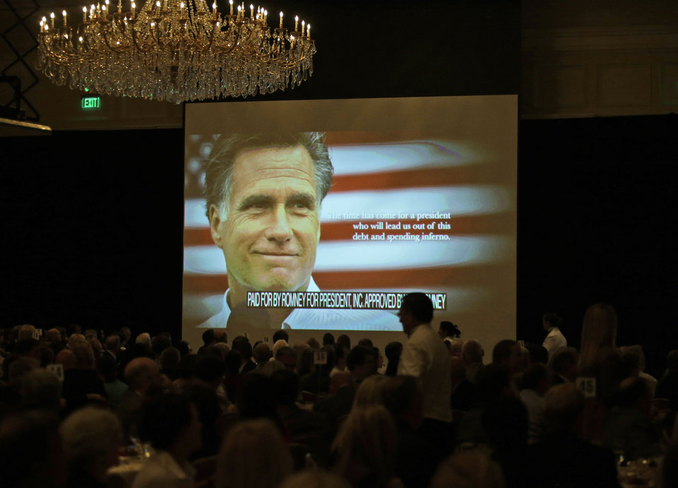 Photo -   A campaign film is shown before Republican presidential candidate and former Massachusetts Gov. Mitt Romney speaks at a campaign fundraising event at The Grand America in Salt Lake City, Utah, Tuesday, Sept. 18, 2012. (AP Photo/Charles Dharapak)