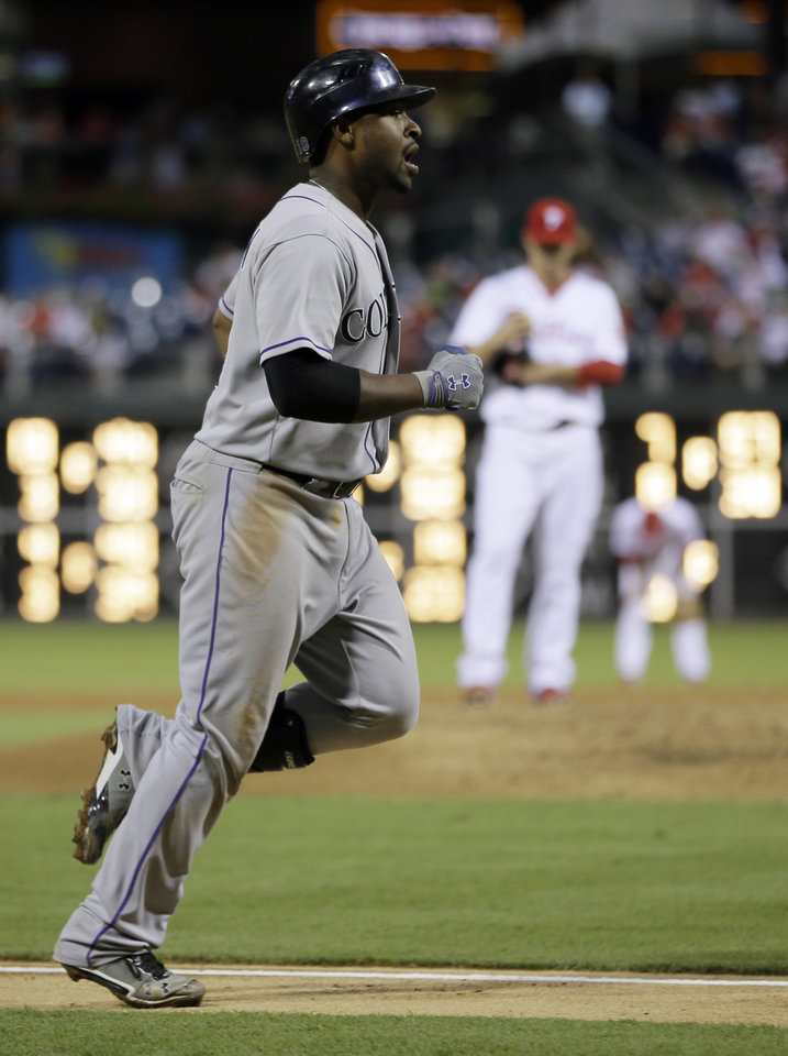 Photo -   Colorado Rockies' Chris Nelson rounds the bases after hitting a three-run home run off Philadelphia Phillies starting pitcher Tyler Cloyd in the third inning of the second game of a baseball doubleheader on Sunday, Sept. 9, 2012, in Philadelphia. (AP Photo/Matt Slocum)