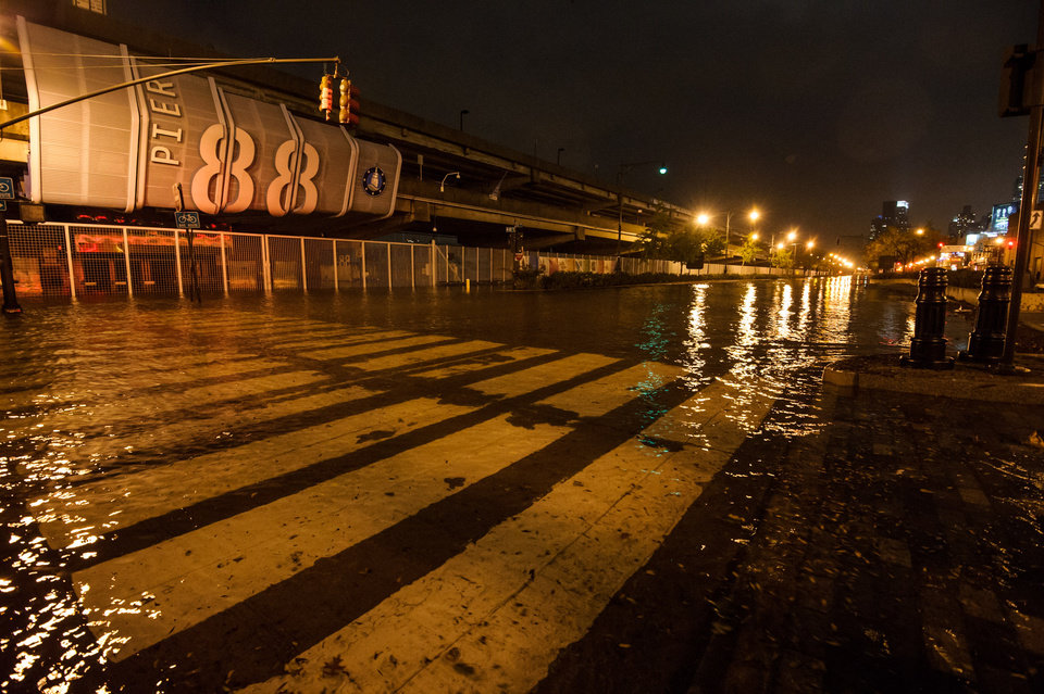 Photo -   This photo provided by Dylan Patrick shows flooding along the Westside Highway as Sandy moves through the area Monday, Oct. 29, 2012 in New York. Much of New York was plunged into darkness Monday by a superstorm that overflowed the city's historic waterfront, flooded the financial district and subway tunnels and cut power to nearly a million people. (AP Photo/Dylan Patrick) MANDATORY CREDIT: DYLAN PATRICK