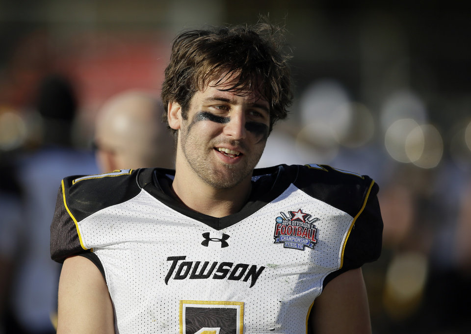 Photo - Towson quarterback Peter Athens (7) walks along the bench talking with teammates late in the second half of the FCS championship NCAA college football game against North Dakota State, Saturday, Jan. 4, 2014, in Frisco, Texas. NDSU won 35-7. (AP Photo/Tony Gutierrez)