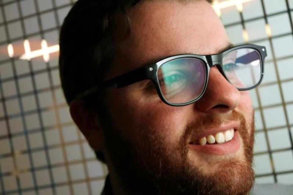 Photo -  Austin Green, CEO of BlyncSync, wears the smart glasses his company produces.  [Doug Hoke/The Oklahoman]